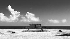 Take a sit (ryancurier) Tags: sea sky blackandwhite mer monochrome clouds contrast canon bench landscape island 50mm blackwhite view noiretblanc maurice ile ciel sit mauritius nuages paysage vue banc 450d