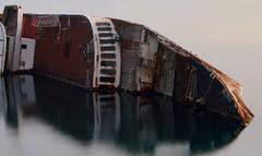 Mediterranean sky shipwreck (Michail Kalognomos) Tags: sea water canon landscape eos boat rust long exposure waterfront sink outdoor greece shipwreck 75300 ghostship 70d mediterraneansky eleusina