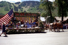 aspen-07-76-26 (ndpa / s. lundeen, archivist) Tags: street houses costumes homes summer horses people horse color film buildings centennial women mainstreet colorado flag nick july americanflag parade celebration rockymountains horsedrawn 1970s aspen float 4thofjuly festivities bicentennial 1976 dewolf photographerunknown ohbejoyful mid1970s aspenmountain nickdewolf americanbicentennial coloradocentennial moorerealty