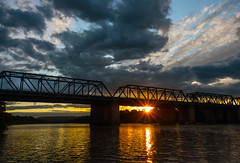 Sunset over the Nepean Bridge (Tortie Cat) Tags: sunlight river australia nepean penrith waterreflection victoriabridge sunstar