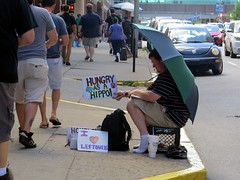 In a sea of people the HIPPO GUY is a private island. (kennethkonica) Tags: street city summer people urban usa hat america canon midwest sitting random outdoor candid indianapolis seat streetphotography indy indiana sit persons seated begging beg global canonpowershot marioncounty hossier hungryasahippo hippoguy