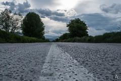 Tornando dal lavoro... (Luca Angelini) Tags: strada italia nuvole controluce abruzzo prospettiva contrasto cielogrigio pescina cielogrigioalbero