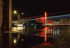 Geary Parkway Motel, Alley View (RZ68) Tags: street light red black reflection green cars wet rain sign night dark puddle san francisco neon angle district low wide trails motel ground down richmond velvia level parkway geary kia showers provia rz67 e100