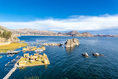 Lake Titicaca Floating Islands (choloboliviano) Tags: world travel houses sky plants house lake home peru reed titicaca nature water inca rural america reeds landscape boats outdoors island islands boat cabin village outdoor south floating bolivia huts copacabana andes titikaka indigenous thatched