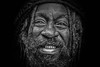 Looking inside out (eyecandyclick) Tags: charity blackandwhite reflection dreadlocks dark beard outside hope eyes peace expression empty teeth streetlife lips features facialhair dreads jamaican desperation meaning justforyou eyecandyclick