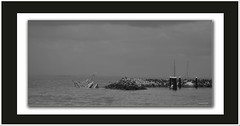 Trawler sinks in Redcliffe harbour. (agphoto100) Tags: storm men water clouds canon boat waiting rocks border overcast frame mooring jpg aground sunk trawler peir a710is blackwhitemono