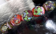 Rocks Red Orange Jungle Frosted (Laura Blanck Openstudio) Tags: show blue red etched orange usa abstract green art glass leaves festival set beads rocks colorful aqua warm published artist glow purple handmade stones eggplant turquoise burgundy fine arts bordeaux peach violet lavender plum funky pebbles made odd lilac earthy jungle faceted winner mauve opaque bead organic transparent wearable nuggets murano lampwork beaded multicolor raku artisan matte whimsical loose frosted frit openstudio asymmetric ocher tumbled openstudiobeads