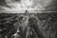 Alien Landscape (Martyn.Smith.) Tags: ocean uk england bw seascape beach canon landscape eos mono coast photo seaside rocks flickr image devon coastline rockybeach rugged rockformations sigmalens hartlandquay 700d niksilverefex devonbeaches