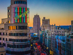 Gran Via, Madrid (Chris Gouge) Tags: madrid life street city travel sunset sky urban colour architecture real lights twilight spain europe cityscape dusk vibrant via gran colourful authentic schweppes