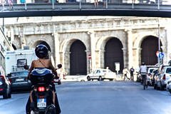 Woman on Scooter (macmcintire) Tags: city rome driving helmet scooter colosseum