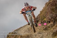 Jumping for Joy (Sylvia Slavin ARPS (woodelf)) Tags: mountain bike sport race jump events lakes bikes mtb nutcracker xc winlatter