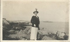 High style on the rocks (912greens) Tags: ocean sea fashion women rocks alone feather hats pride 1900s folksidontknow