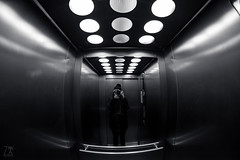 Selfie in the Elevator (Zano91) Tags: portrait blackandwhite bw white distortion black reflection monochrome myself person lights reflecting mirror nikon mood shadows distorted curves elevator bn fisheye shooting curve 8mm selfie f35 samyang d7100