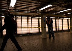 Caution (UrbanphotoZ) Tags: nyc newyorkcity ny newyork station silhouette subway lights workmen manhattan indoor midtown tape fluorescent timessquare caution panels westside beams concourse