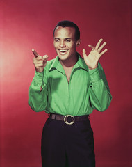 Harry Belafonte 1996 (Santa Clara University) Tags: portrait people musician music male men smiling fashion one shot adult gesturing singer prominentpersons actor microphone celebrities studioshot pointing halflength studioportrait oneperson facialexpression redbackground harrybelafonte midadult midadultman coloredbackground africanethnicity otherkeywords africanamericanethnicity
