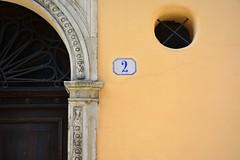 Two (mikael_on_flickr) Tags: door city 2 two urban muro yellow wall decorative decoration number gelb giallo porta deux ferrara ochre due zwei gul numero citt emiliaromagna decorazione urbanity nummer yellowochre dittico diptycg
