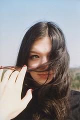 (EYLUL ASLAN) Tags: blue red sky berlin film girl face dark hair spring hand nail touch brunette