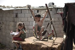 Palestinian children play outside their house in Khan Younis town, southern Gaza strip (TeamPalestina) Tags: sunset sky sun sunrise landscape landscapes photo am amazing nice photographer natural sweet live palestine comfort sunrays gaza beautifull palestinian  landscapecaptures