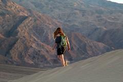 Walking down the sand hills (daveynin) Tags: sunset shadow mountain walking sand desert nps hiking dunes deathvalley marlena