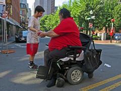 BostonStrawberryHandoff (fotosqrrl) Tags: urban boston massachusetts wheelchair streetphotography strawberries haymarket hanoverstreet maninneed