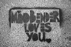 mindbender loves you  (Ian Muttoo) Tags: bw toronto ontario canada stencil pavement gimp ashphalt  ufraw mindbender mindbenderlovesyou dsc52421edit