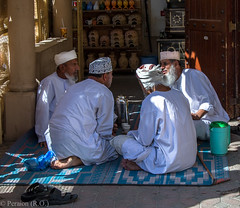 Chat over a 'Coffee Break', Oman (Peraion) Tags: men asia group middleeast objects arab rug turban chatting oman shelves thermos coffeemugs