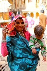 Rajasthani_women_child (manjiriaphale) Tags: people cold smile silver women child faces traditional mother rajasthan parda rajasthani traveldiary jwellery pallu
