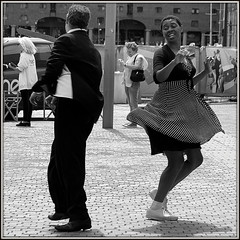 Swinging in the street (* RICHARD M) Tags: street liverpool fun happy mono blackwhite dancers dancing action candid performance happiness entertainment polkadots swinging cobbles performers lindyhop swingdancing albertdock jitterbug swingdance swingers merseyside lindyhoppers entertainers jitterbugs capitalofculture polkadotdress swingdancers cobbledstreet dancinginthestreets europeancapitalofculture jitterbugging lindyhopping swingdances unescocityofmusic jitterbuggers maritimemercantilecity swingisking
