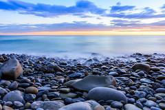Riomaggiore's pebble beach (pn.praveen) Tags: blue sunset sea italy mediterranean liguria pebbles pebblebeach cinqueterre riomaggiore 5villages riomaggiorebeach liguriacoastline