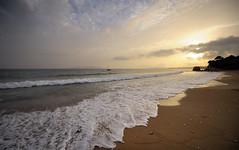 Sunset on the sandy beach (Sunsword & Moonsabre) Tags: sunset sea sky sunlight beach colors clouds coast boat sand nikon europe day waves colours cloudy sandy greece foam beaches balkans nikkor balkan ionian peloponnese d700 1424f28 nikonfx
