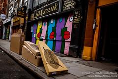 Guitar packaging outside a saxophone shop on Denmark Street, London