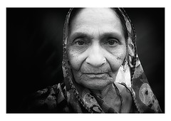 the age of wisdom (handheld-films) Tags: old travel portrait people blackandwhite woman india closeup blackbackground female mono women faces indian elderly portraiture wise aged isolated subcontinent