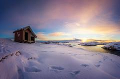 Snow (Arvid Bjrkqvist) Tags: pink blue winter light sunset panorama orange sun moon lighthouse house cold yellow clouds purple sweden path pano horizon wide footprints footsteps rays buoy tjurpannan