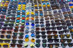 Mercato nella zona dei navigli. Open-air market in the Navigli neighbourhood (paolo.gislimberti) Tags: sunglasses reflections glasses market bazaar spectacles riflessi mercato bazar occhiali marketstalls bancarelle occhialidasole