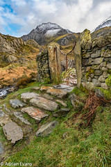Decorative Iron Gate (Adrian Evans Photography) Tags: uk winter sky snow mountains fern ice face stone wall wales clouds creek fence river landscape gate rocks track riverside outdoor path decorative steps entrance landmark snowcapped trail valley snowdonia footpath hdr tryfan irongate northwales ogwen devilskitchen cwmidwal idwal snowdonianationalpark llynidwal ogwenvalley adrianevans carneddaumountains tryfanmountain glyderaumountains tryfanface