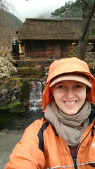 smiling in the rain (eweliyi) Tags: woman me girl smile face hat rain smiling japan self waterfall hoodie village ja kawaguchiko selfie project365 traditionalhouses eweliyi 365v4
