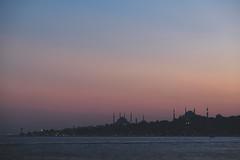 Sunset on the Bosphorus (_Codename_) Tags: pink blue sunset silhouette turkey landscape asia istanbul bluemosque domes hagiasophia bosphorus minarets aghiasophia sultanahmetmosque bosphorusstrait sultanahmedmosque crushedblacks
