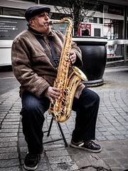 Sounds Saxy (Silver Machine) Tags: street man lumix sitting outdoor streetperformers streetphotography streetportrait cap windsor busker berkshire busking saxophone lumixg lumixg20mmf17 lumixg5