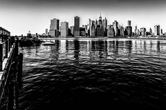 Looking at Manhattan (MacCabri) Tags: city nyc blackandwhite newyork water monochrome skyline canon eos waterfront outdoor manhattan 70d