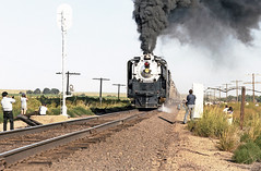 Union Pacific FEF-3 class 4-8-4 Northern steam locomotive # 8444, is seen leading a rail fan excursion train along the main line on a photo run-by in Colorado, Summer 1980 - 2 (alcomike43) Tags: old color classic up modern vintage ties photo colorado tracks engine photographers trains historic passengers negative photograph rails unionpacific locomotive northern spikes steamengine observers railroads onlookers ballast rightofway steamlocomotive 484 alco mainline oilburner passengertrains roadbed railfans 8444 fef3 blocksignal tieplates anglebars conventionaljointedsectionrail railfanexcursiontrains