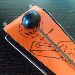Ghostly Flex-a-tone (bindlegrim) Tags: wood 1920s music orange black metal vintage 1930s graphic minimal noisemaker soundeffect