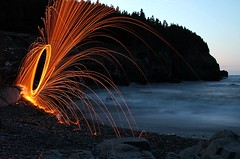 Beach Fire (Karen_Chappell) Tags: ocean longexposure blue orange canada water night newfoundland circle landscape fire evening scenery scenic ring sparks nfld middlecove middlecovebeach spinningsteelwool