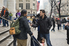 Interview (Igor Voller) Tags: street new york nyc people usa man tree girl saint television america stars us tv kid cathedral stroller stripes flag patrick tourist flags kind backpack microphone mann  avenue press amerika interview mdchen   correspondent              korrespondent        rcksack