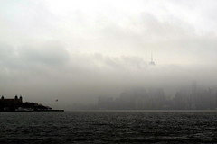 Piercing through the Fog (M.andA.) Tags: christmas new york nyc usa mist ny fog clouds island flag hudson staten skycreeper