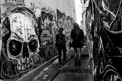 (Georgina ) Tags: blackandwhite monochrome skull graffiti legs steps athens greece prettygirls narrowstreet shortskirt 2girls streetphotgraphy