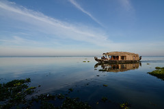 A houseboat moves lazily on the Vembanad. (parmeetkohli) Tags: mist fish mountains coffee trek peace tea country lakes culture kerala jungle gods own toddy kathakali