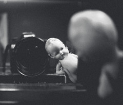 341/366 - Looking Within (Randi Rains Johnson) Tags: blackandwhite stilllife baby cute vintage fun toy miniature doll child play antique fat small bisque norman creepy belly german tiny chubby curlyhair 2012 366 3651