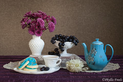 Still life with blue tea pot. (Phyllis Freels) Tags: blue brown white black flower cup cookies fruit vintage purple tea availablelight indoor grapes teapot chrysanthemum tabletop milkglass phyllisfreels stilllifestilllifephotoart