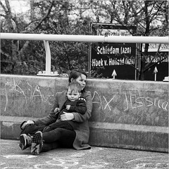 Relaxing on the emergency lane (John Riper) Tags: park street bw woman white black netherlands monochrome sign festival canon john square concrete photography mono chalk kid rotterdam child jessica zwartwit candid mother son lane l emergency shoulder carfree schiedam 6d 24105 hoekvanholland straatfotografie kleinpolderplein autoloos riper johnriper