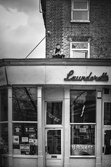 Waiting for it to dry! (sara.wendelmelhuish) Tags: urban bw london mono waiting candid greenwich streetphotography gritty storefront washing launderette se10